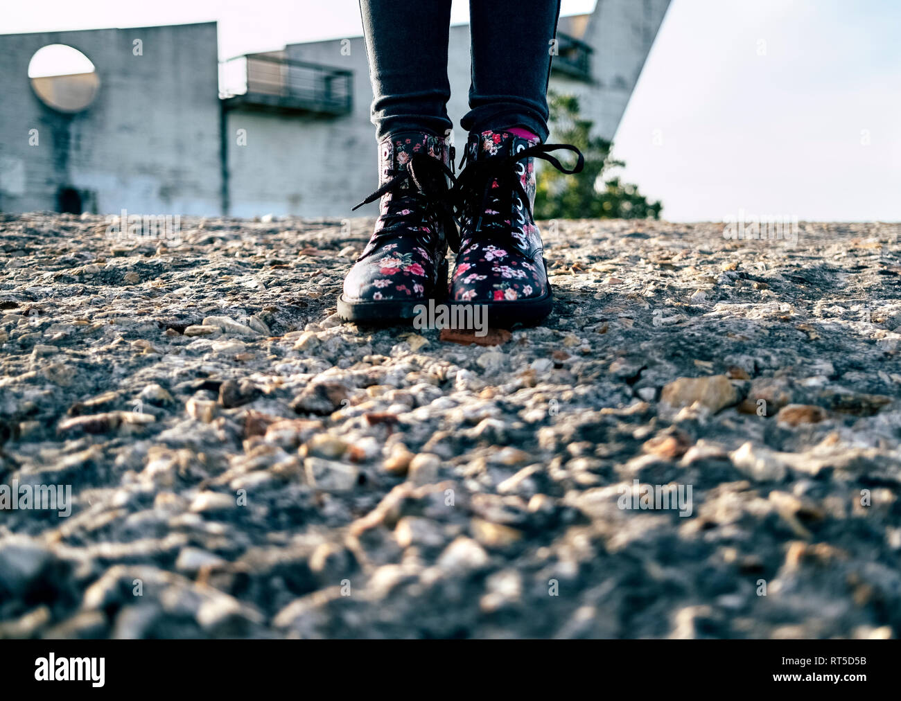 Girl wearing boots with floral design - Stock Image