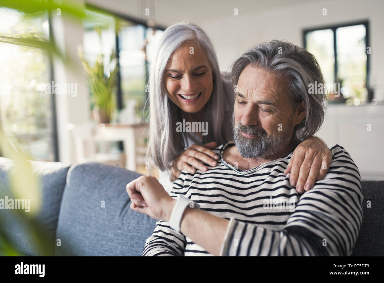 Senior couple looking at smartwatch Stock Photo