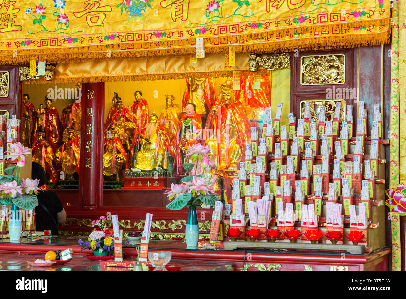 George Town, Penang, Malaysia.  Altar inside Goddess of Mercy Temple, Kuan Yin Teng, Kong Hock Keong.  Wishes and Prayers for Good Fortune on Right. - Stock Image