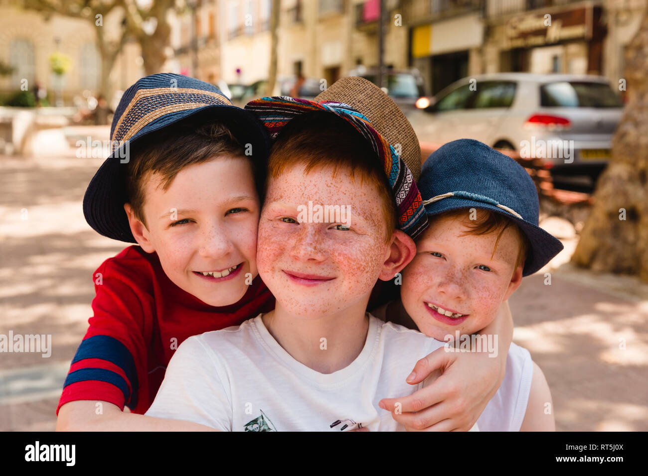 Group picture of three happy boys on holiday Stock Photo