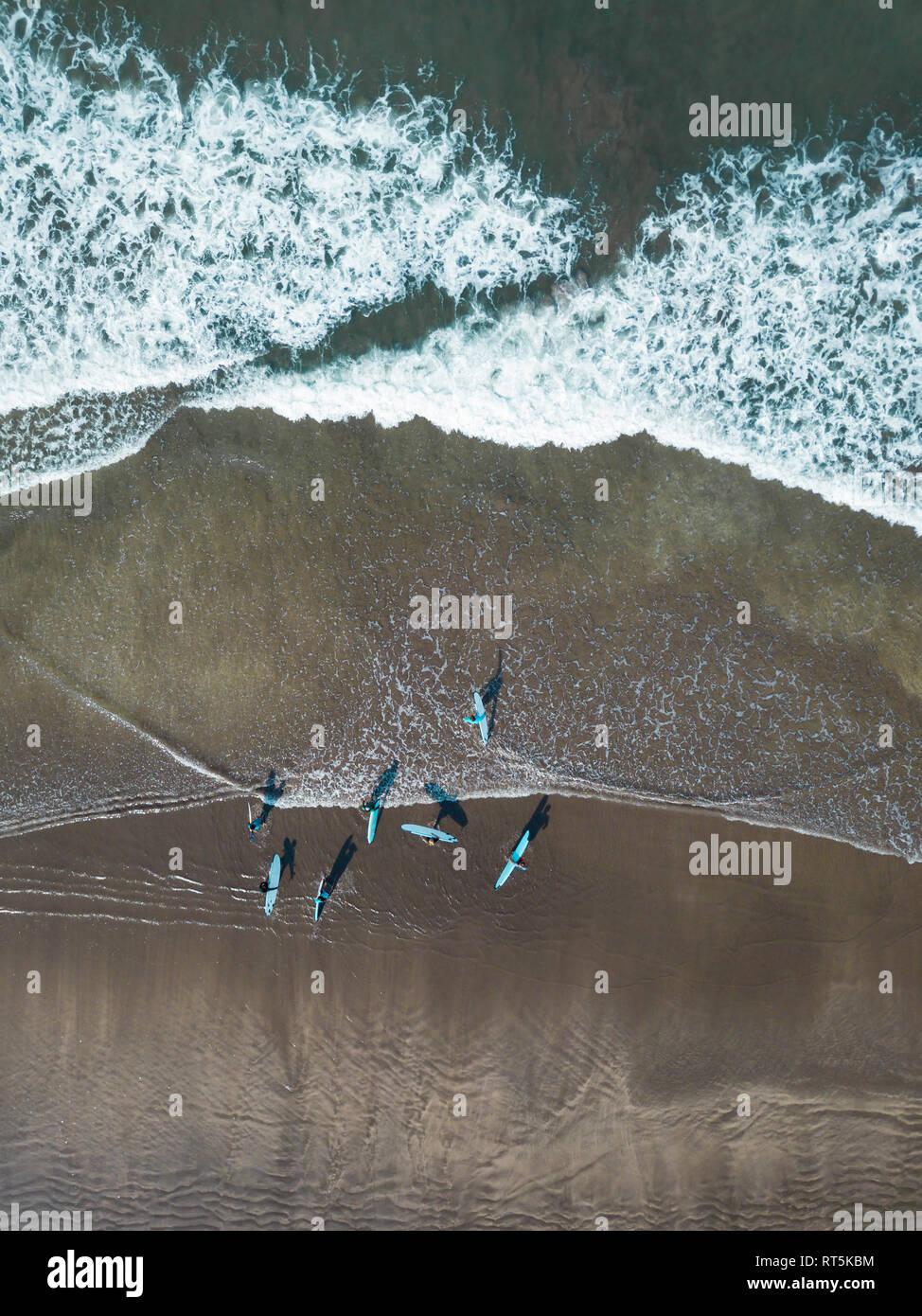 Indonesia, Bali, Kuta beach, surfers - Stock Image