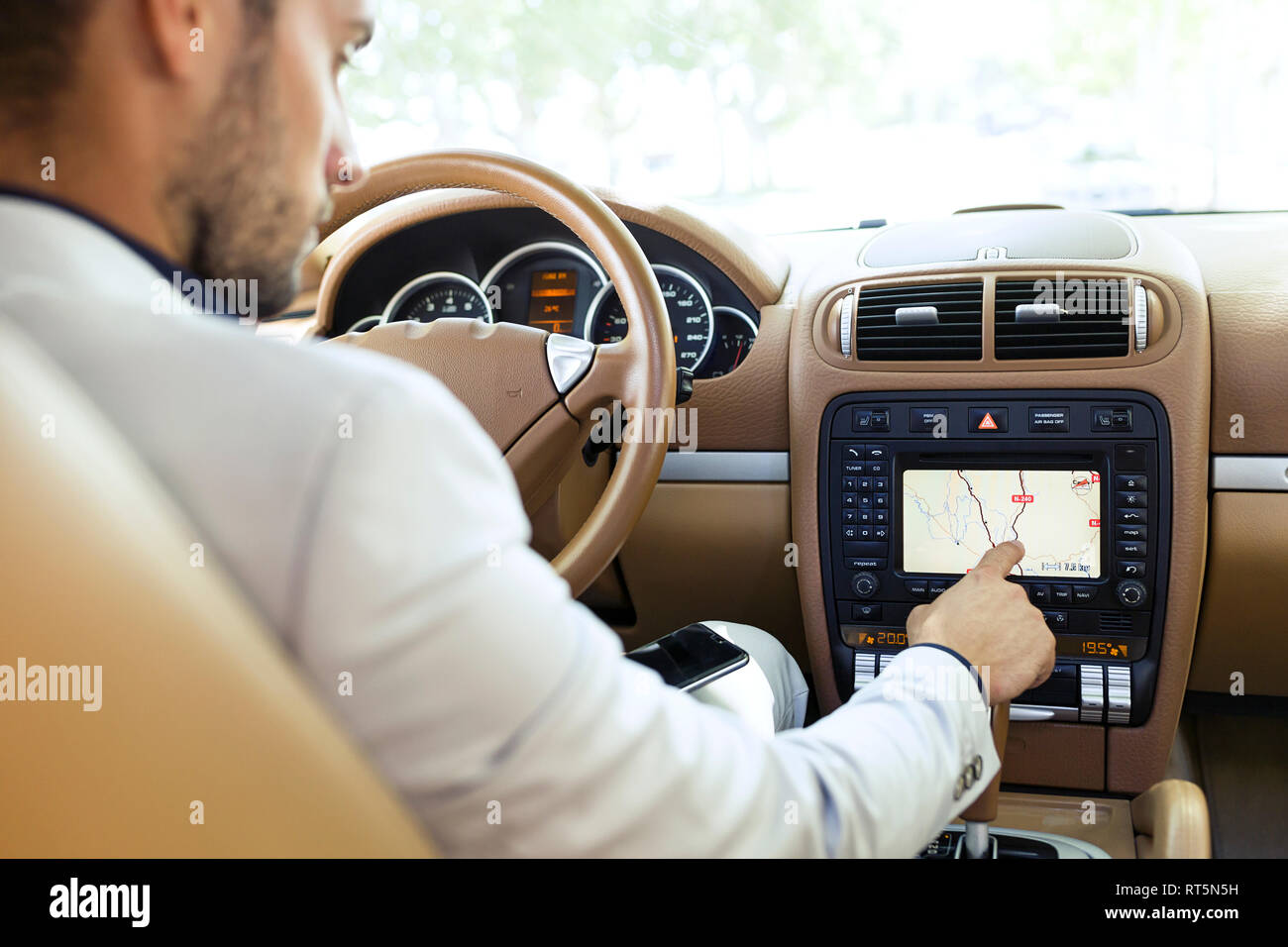 Young businessman using route guiding system in his car Stock Photo