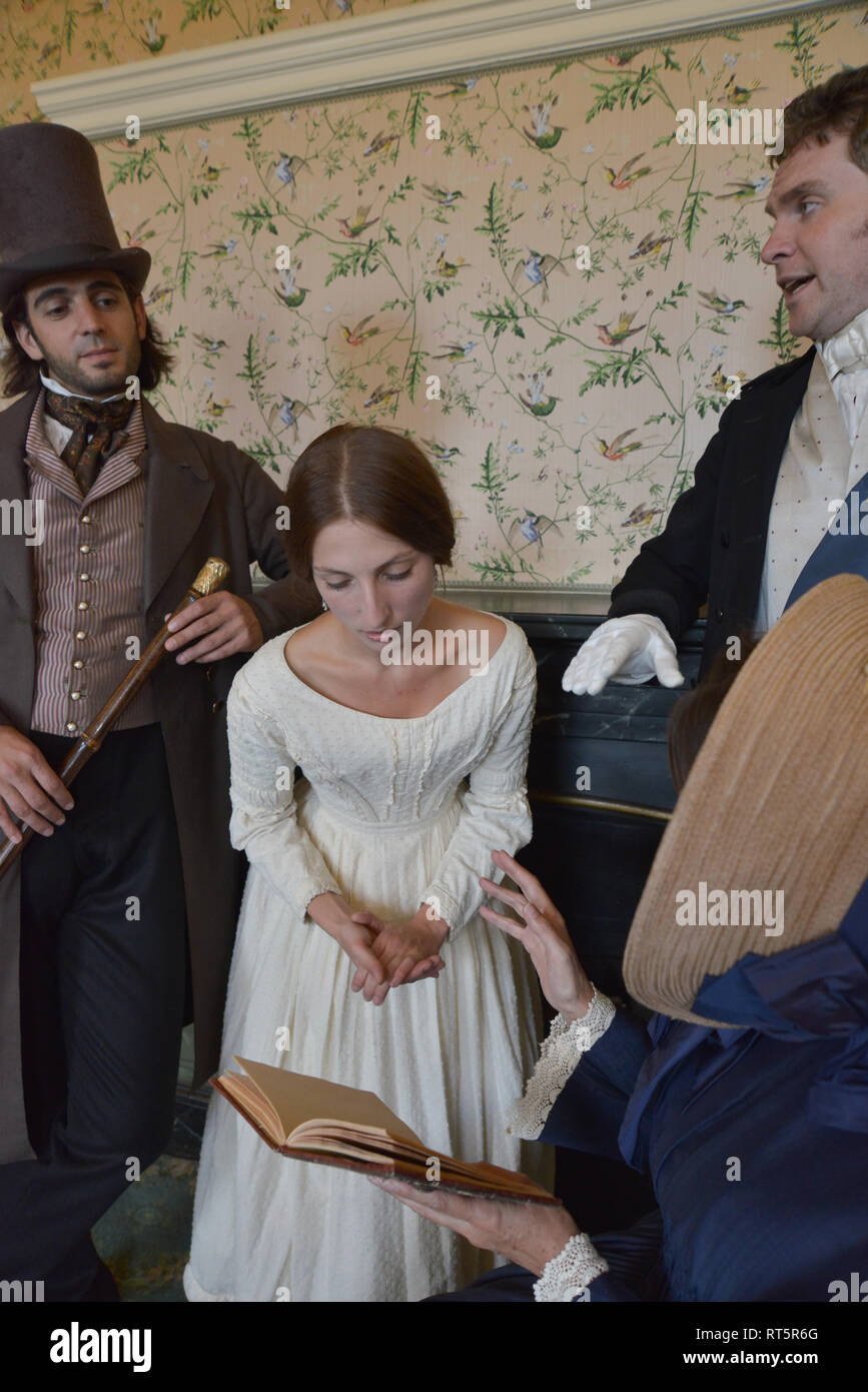 Queen Victoria and Baroness Lehzen are having a meeting with two gentlemen advisors in a room which is actually Queen Victoria's real bedroom - Stock Image