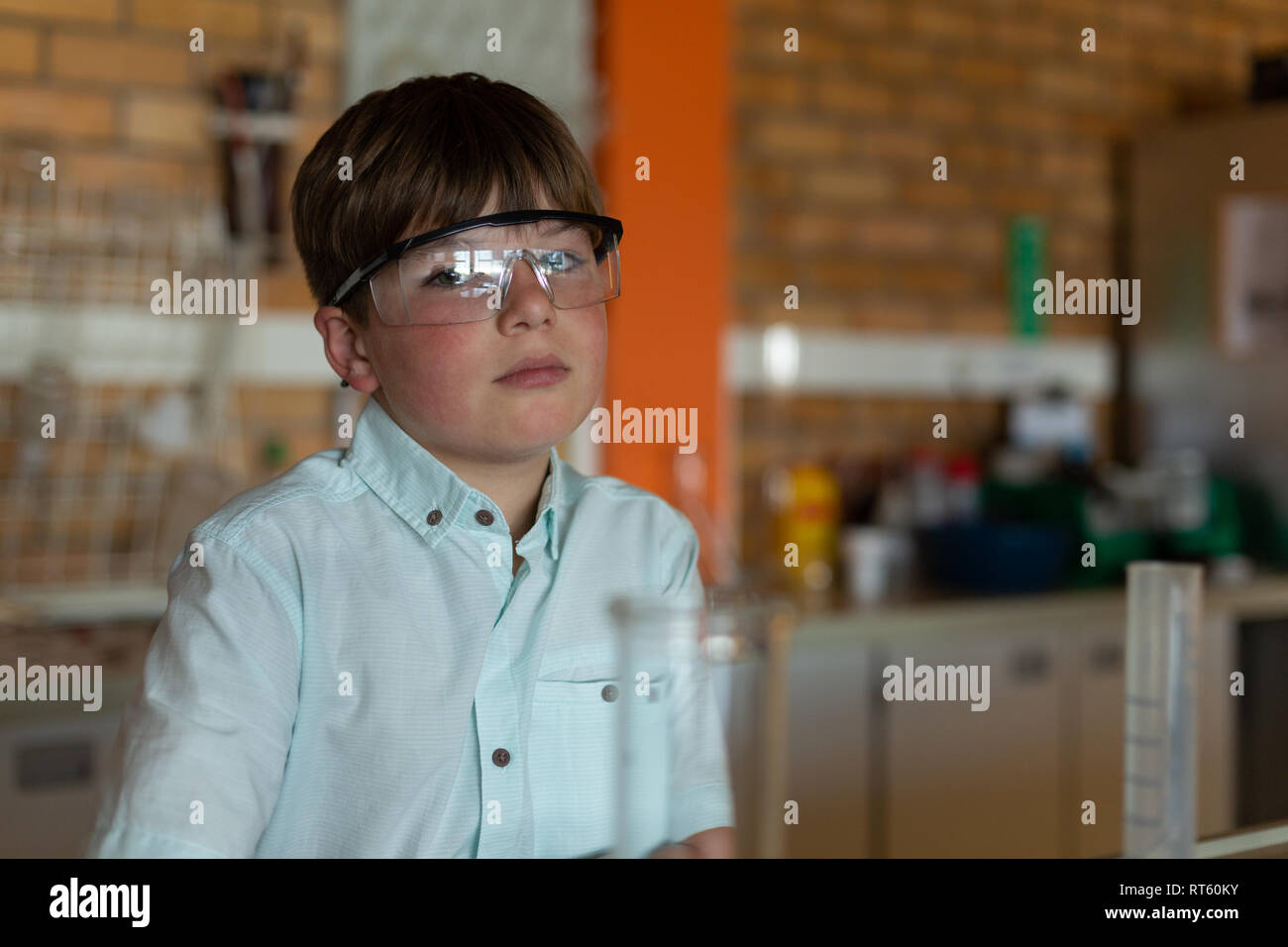 Schoolboy with protective eyewear looking at camera - Stock Image