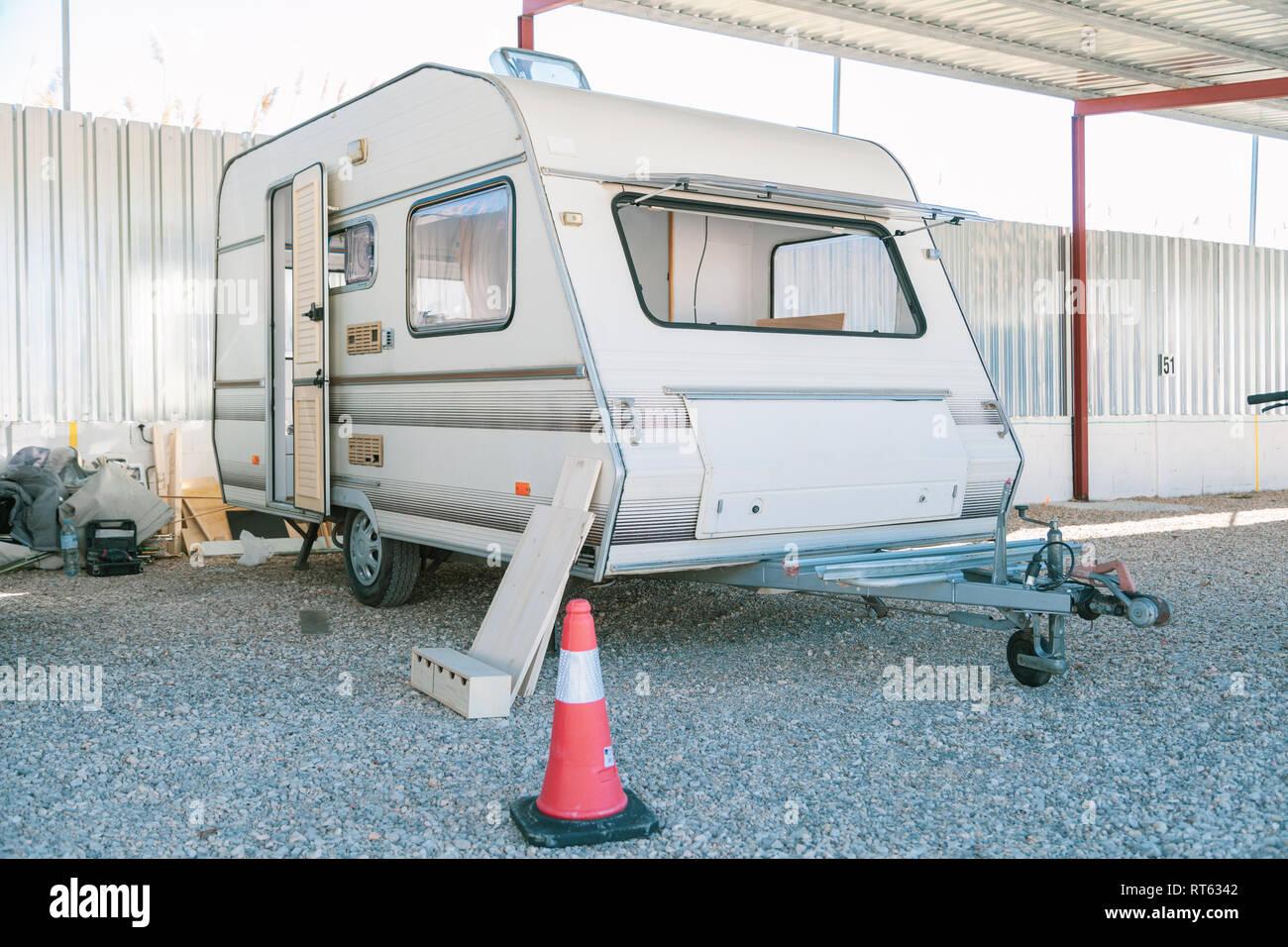 Restoring old caravan with door open - Stock Image