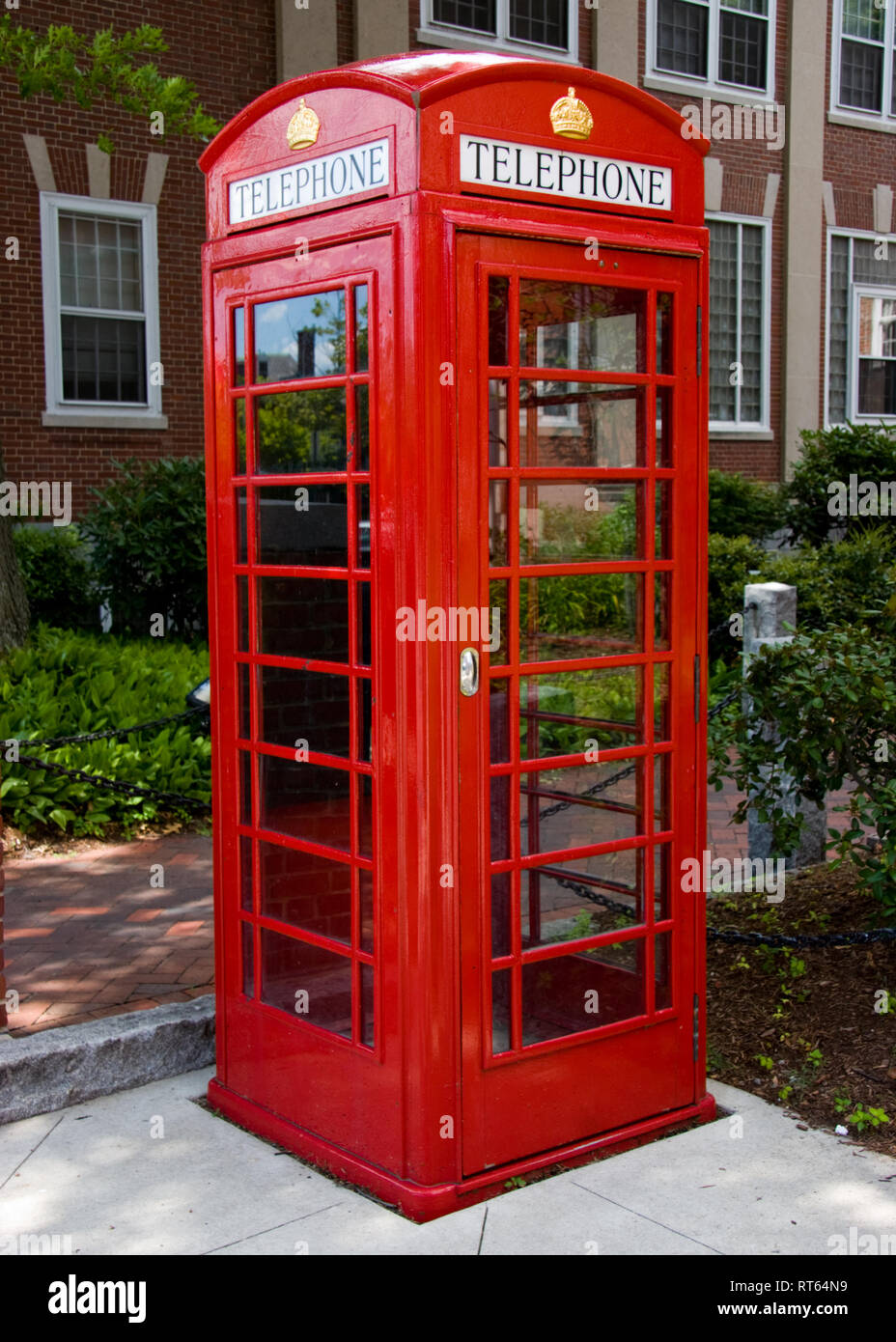 London telephone booth (kiosk) on a side street in Manchester, NH - Stock Image