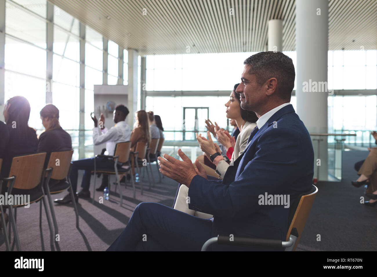 Business people applauding in a business seminar Stock Photo