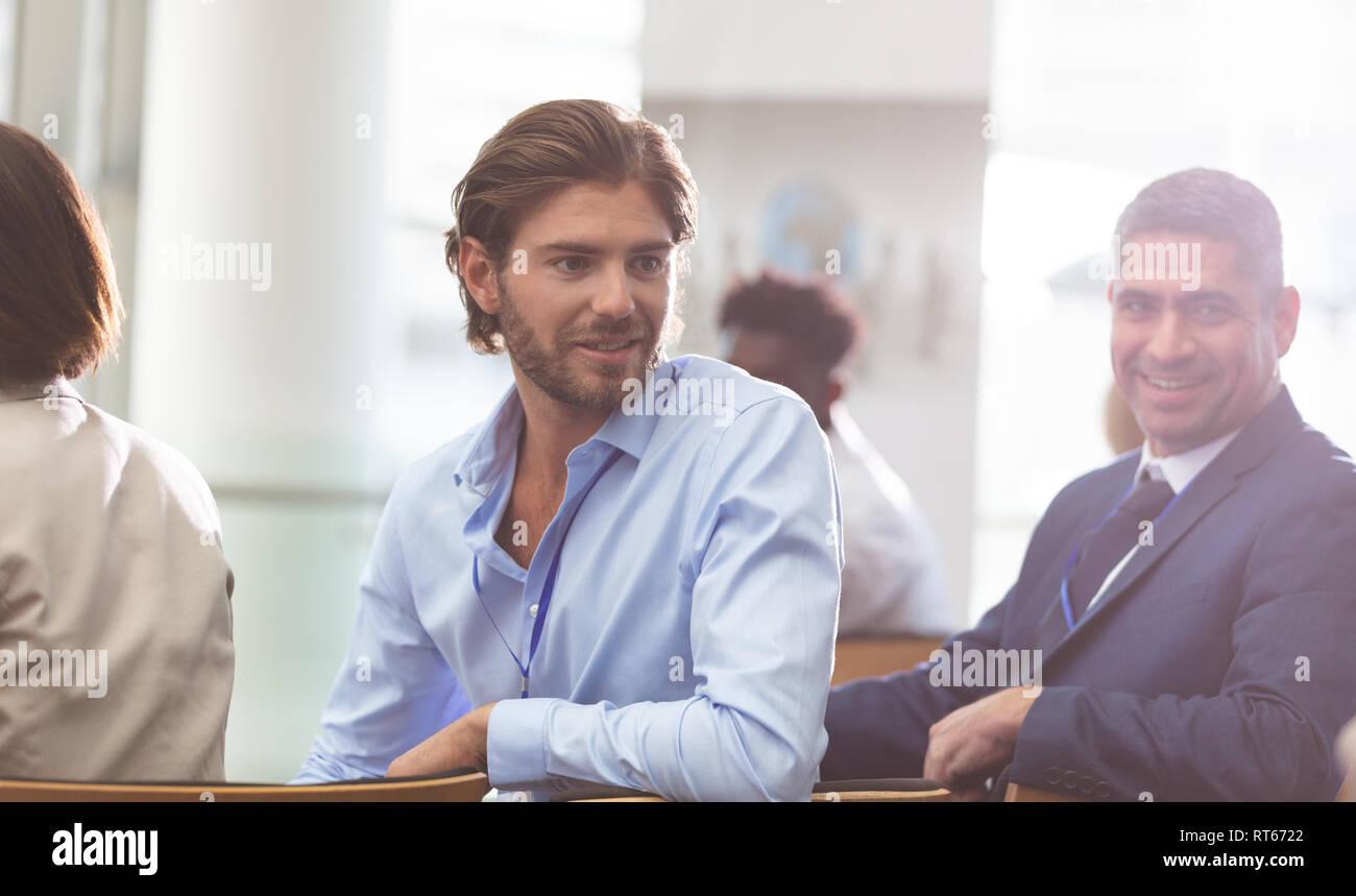 Businessman attending a business seminar - Stock Image