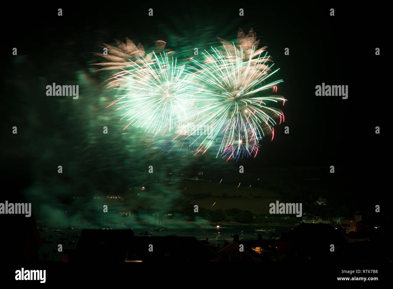 Fireworks over Salcombe Estuary during the Summer regatta, Salcombe, Devon England - Stock Image