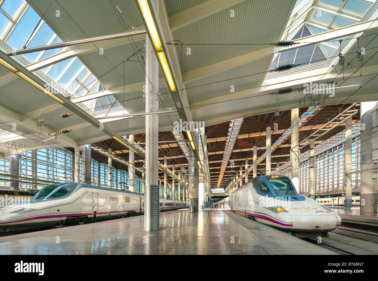 Madrid Atocha train station with AVE Class 102 high speed trains to Cordoba and Malaga. Estacion Puerta de Atocha railway station platform. - Stock Image