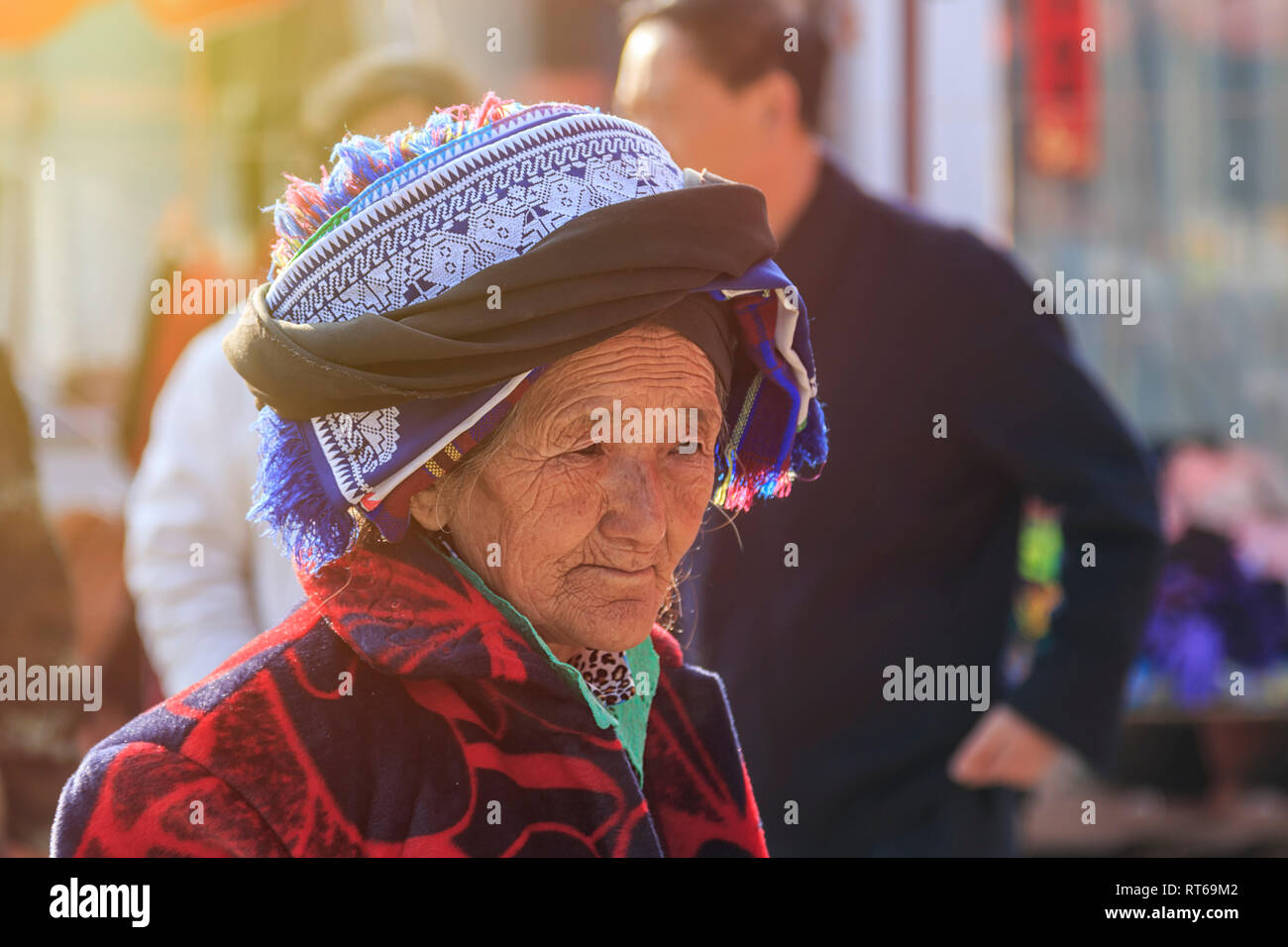 Shaxi, China - February 22, 2019: Portrait of an old Chinese woman in the Friday market in Shaxi old town Stock Photo