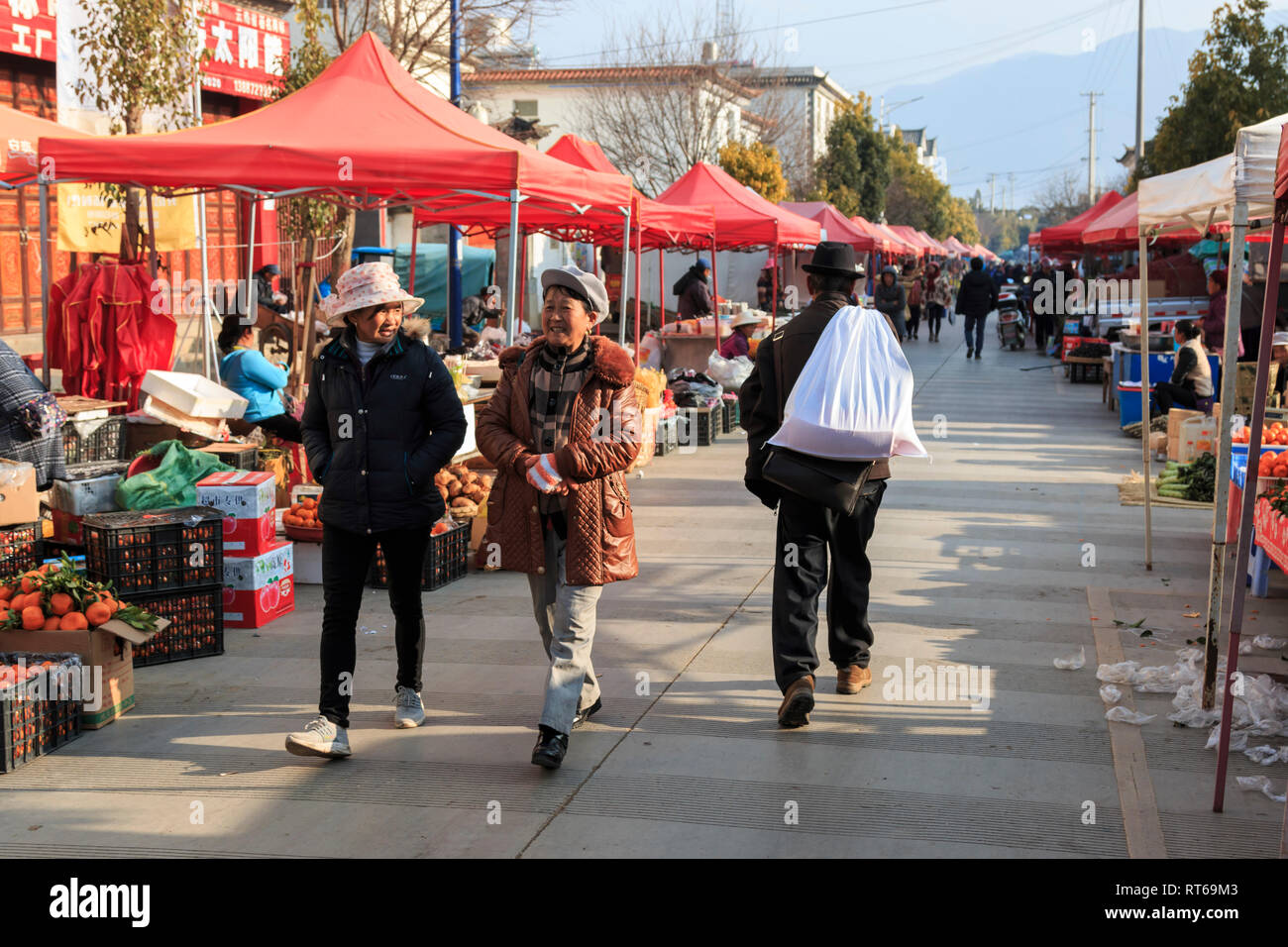 Shaxi, China - February 22, 2019: Chinese women in the Friday market in Shaxi old town Stock Photo