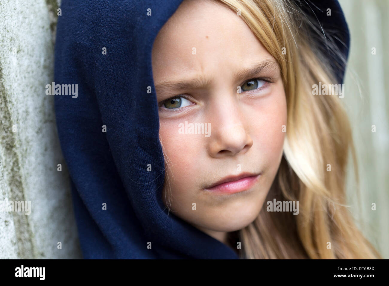 Portrait of unhappy blond girl - Stock Image