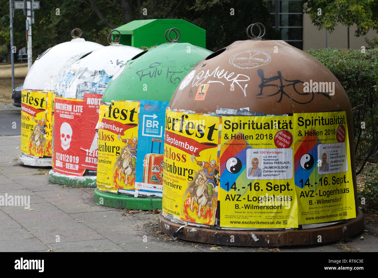 Recycle bins covered in flyers in Berlin Germany - Stock Image