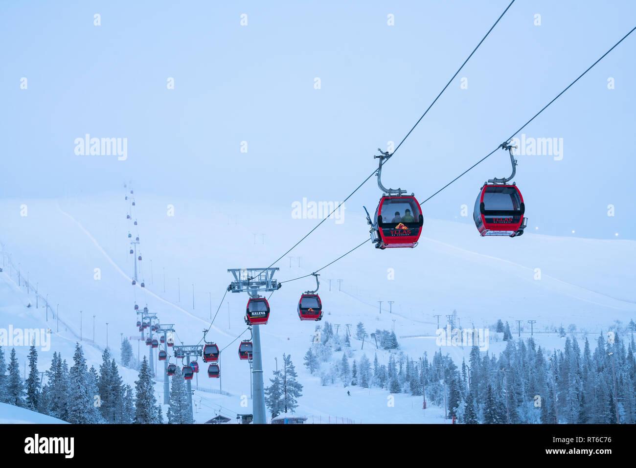 Ylläs ski resort and gondola lift with people in them in Kolari and Äkäslompolo, Finland Stock Photo