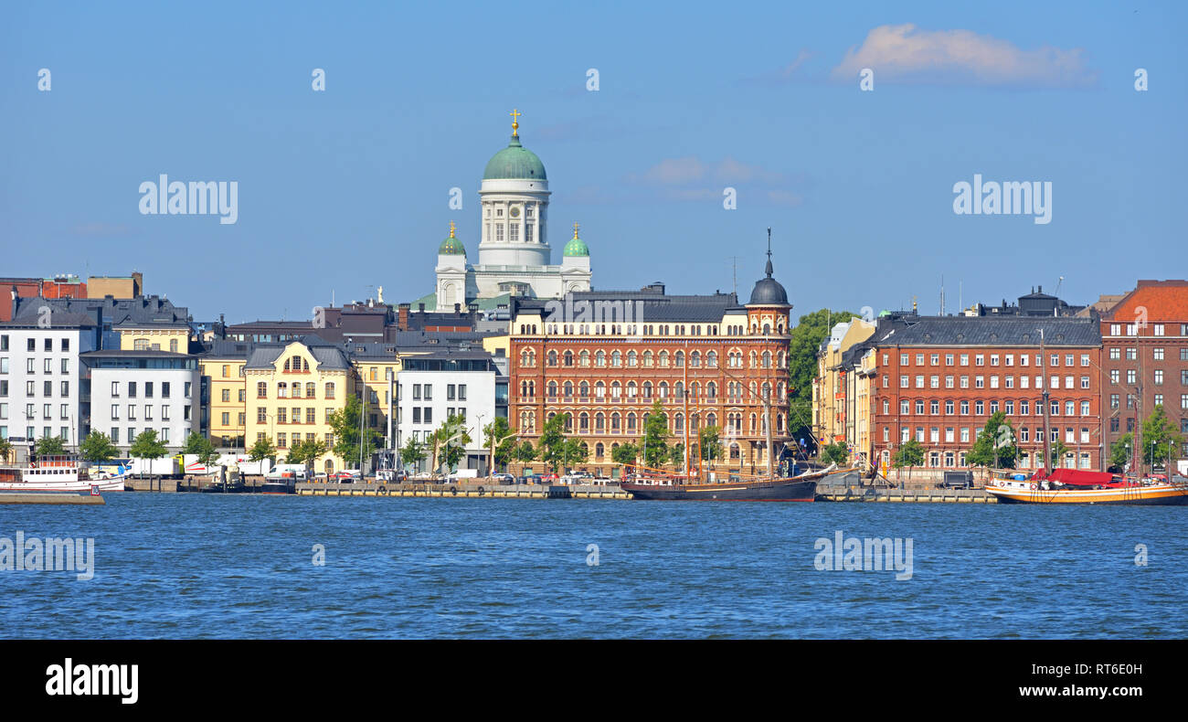 Pohjoisranta embankment, harbor with yacht and ships on background of Finnish Evangelical Lutheran cathedral of Dio Stock Photo