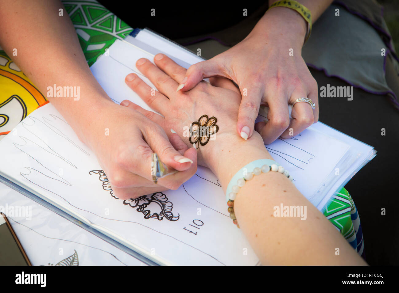 Henna tattooing at Beltane Fire Festival, Sussex, UK - Stock Image