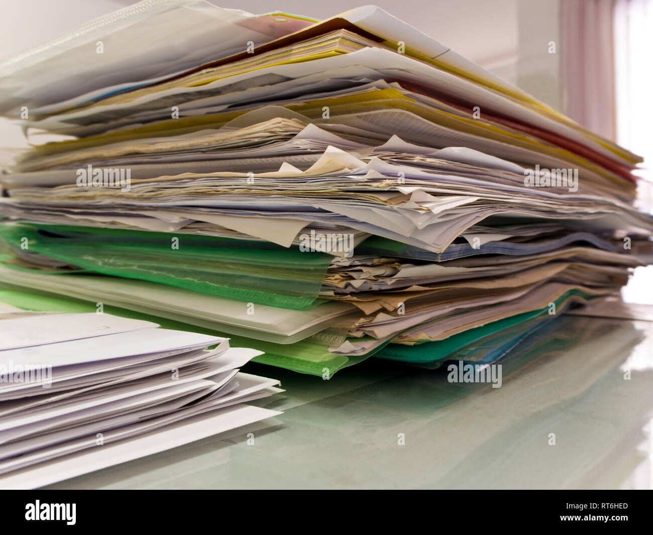 Stacked of paper documents in the office - Stock Image
