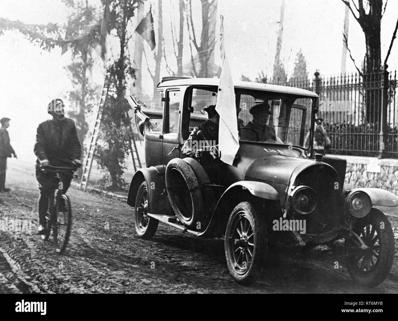 German officers pointing out the location of the mines they had layed along the roads and carious other places. They are seen in one of their own cars with a white flag on the machine - Stock Image