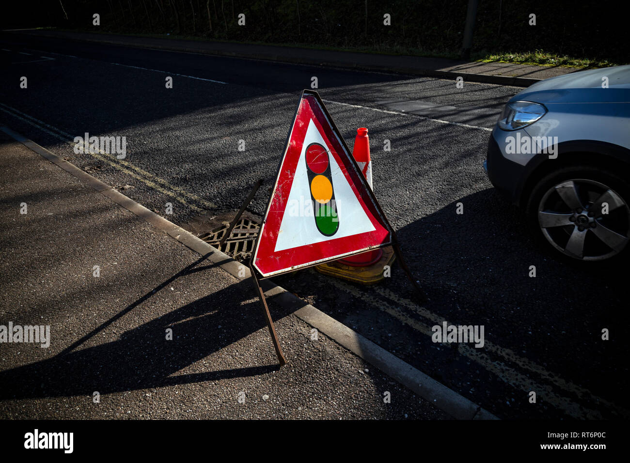 Temporary, Stoplight, Driving, Red, Road, UK, Road Construction, Road Sign, Warning Sign, Advice, Alertness, Assertiveness, Awe, Brown, Communication, - Stock Image