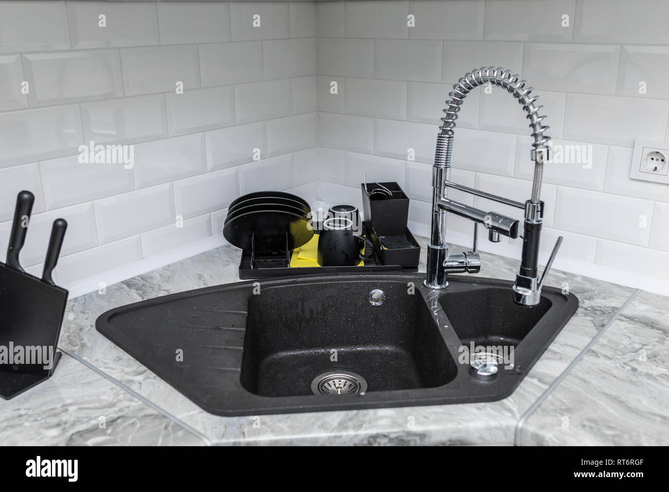Black Kitchen Sink And Tap Water In The Kitchen The Interior Of The Kitchen Room Of The Apartment Built In Appliances Kitchen Appliance Stock Photo Alamy