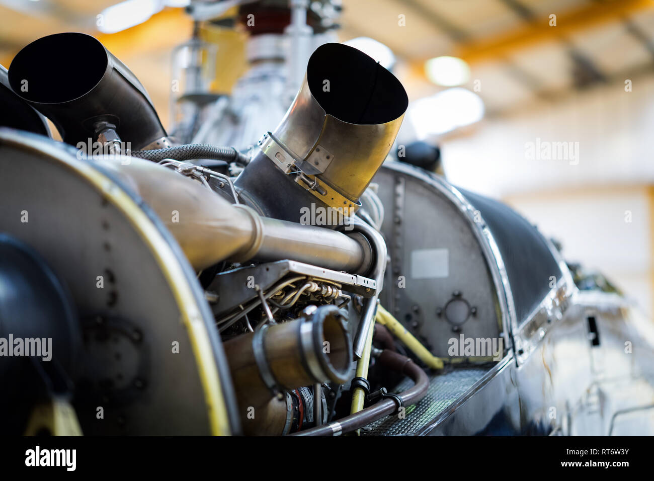 A close up of the engine on an A-109 helicopter undergoing maintenance. - Stock Image