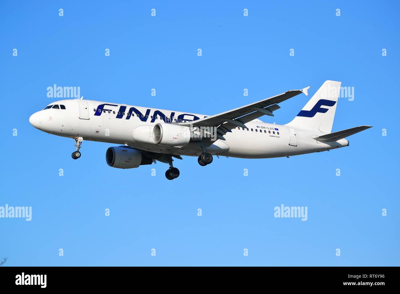 Finnair Airbus A320 OH-LXC landing at London Heathrow Airport, UK - Stock Image