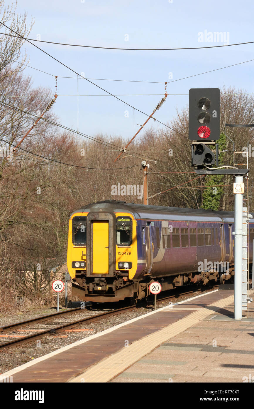 Class 156 super sprinter diesel multiple unit in Northern livery arriving at Lancaster station platform 1 on 25th February 2019. - Stock Image