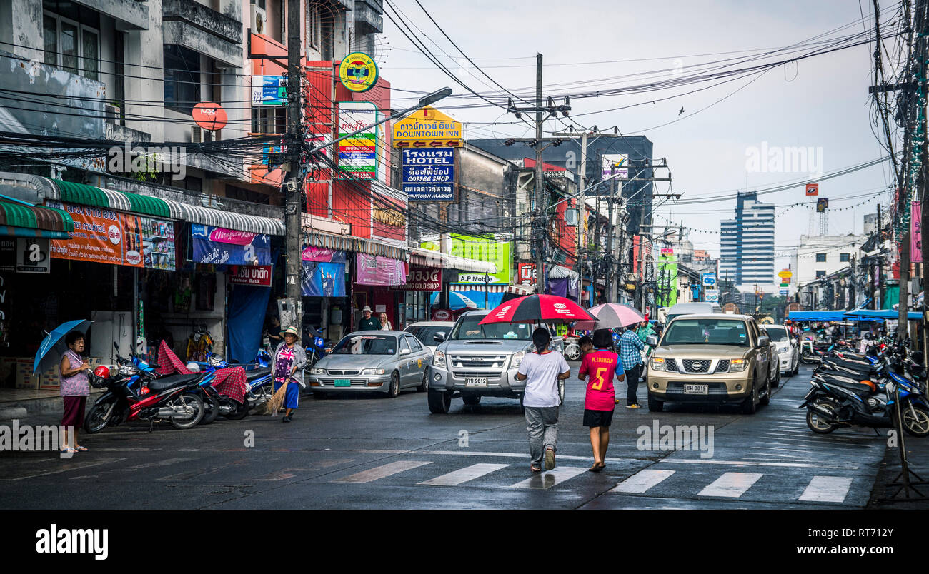 Street in Phuket, Thailand, during a rainstorm. - Stock Image