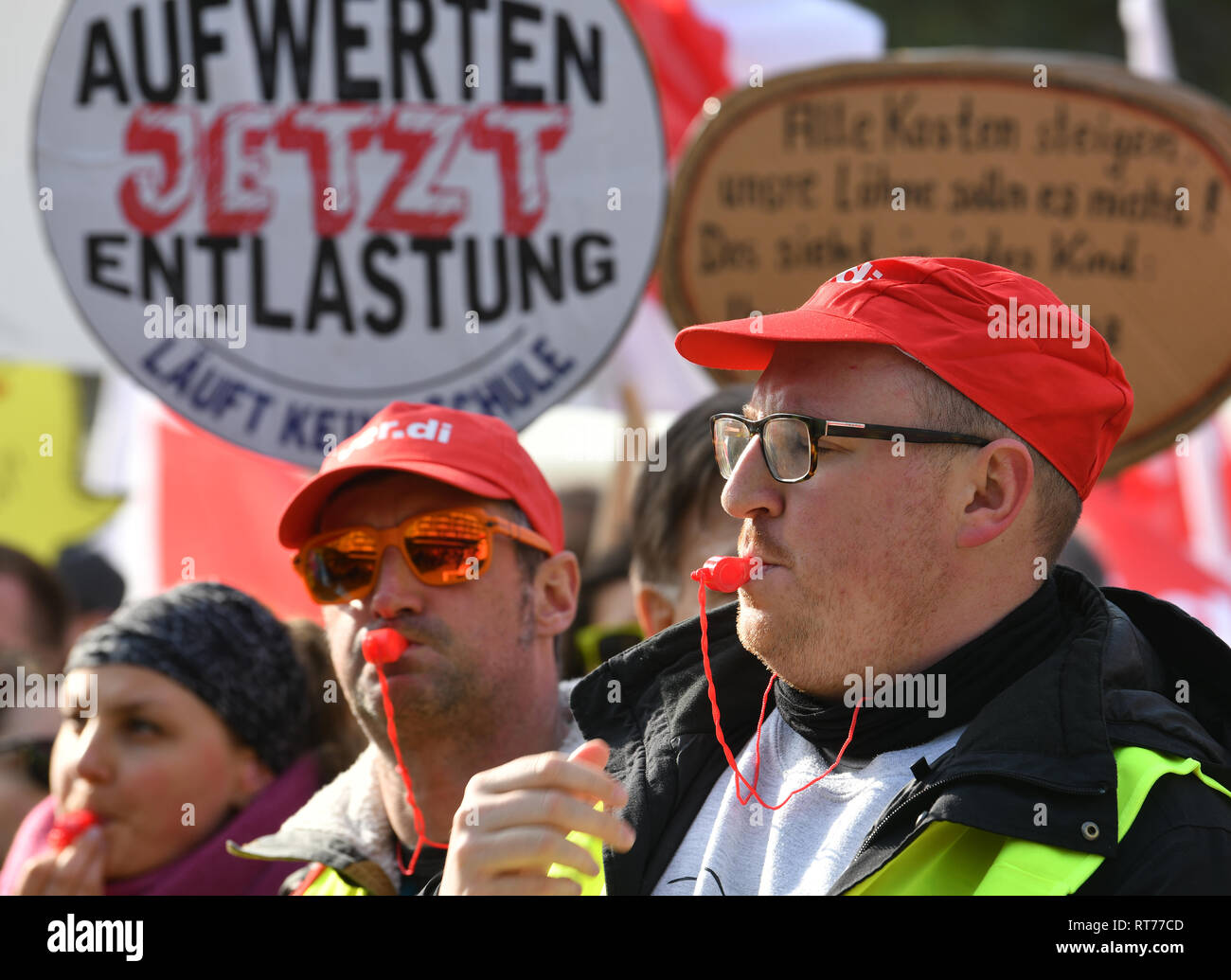 Potsdam, Germany. 28th Feb, 2019. Trade unionists demonstrate with whistles and posters before the start of the third round of collective bargaining in the public service of the states. After the warning strikes, a conclusion to this round of negotiations is expected this weekend. Credit: Bernd Settnik/dpa-Zentralbild/dpa/Alamy Live News - Stock Image