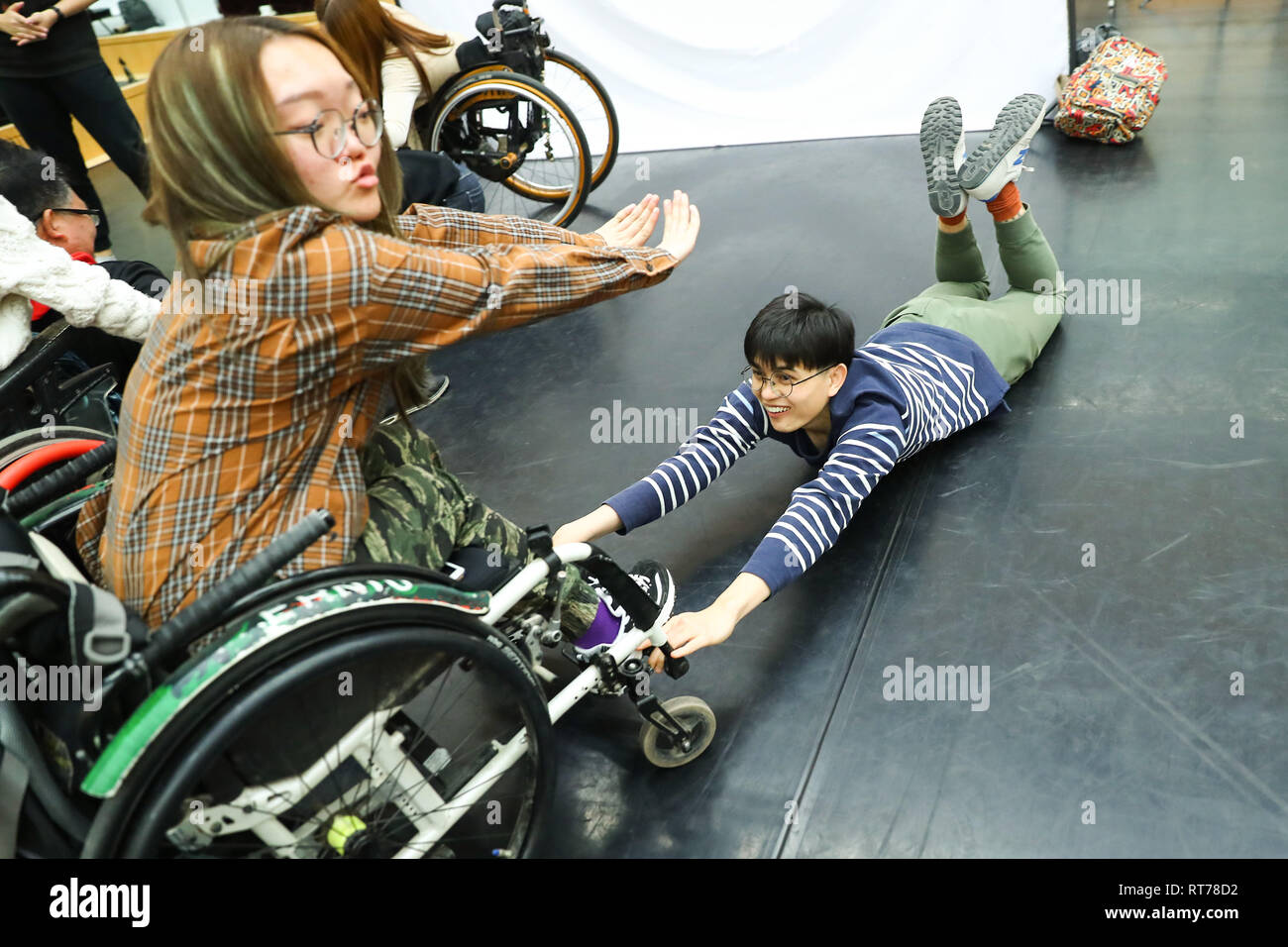 (190228) -- BEIJING, Feb. 28, 2019 (Xinhua) -- Rare disease patients Ding Yuan (L) and Pan Longfei take a body training during an acting workshop for 'Rare Hug', a drama on rare diseases, at Beijing Tianqiao Performance Arts Center in Beijing, capital of China, Feb. 21, 2019. 'Rare Hug,' a Chinese drama on rare diseases, was staged at the Beijing Tianqiao Performing Arts Center Wednesday evening to mark the 12th Rare Disease Day, which falls on Feb. 28, 2019 under the theme 'Bridging Health and Social Care.'     The drama was played by rare disease patients in collaboration with their relative - Stock Image