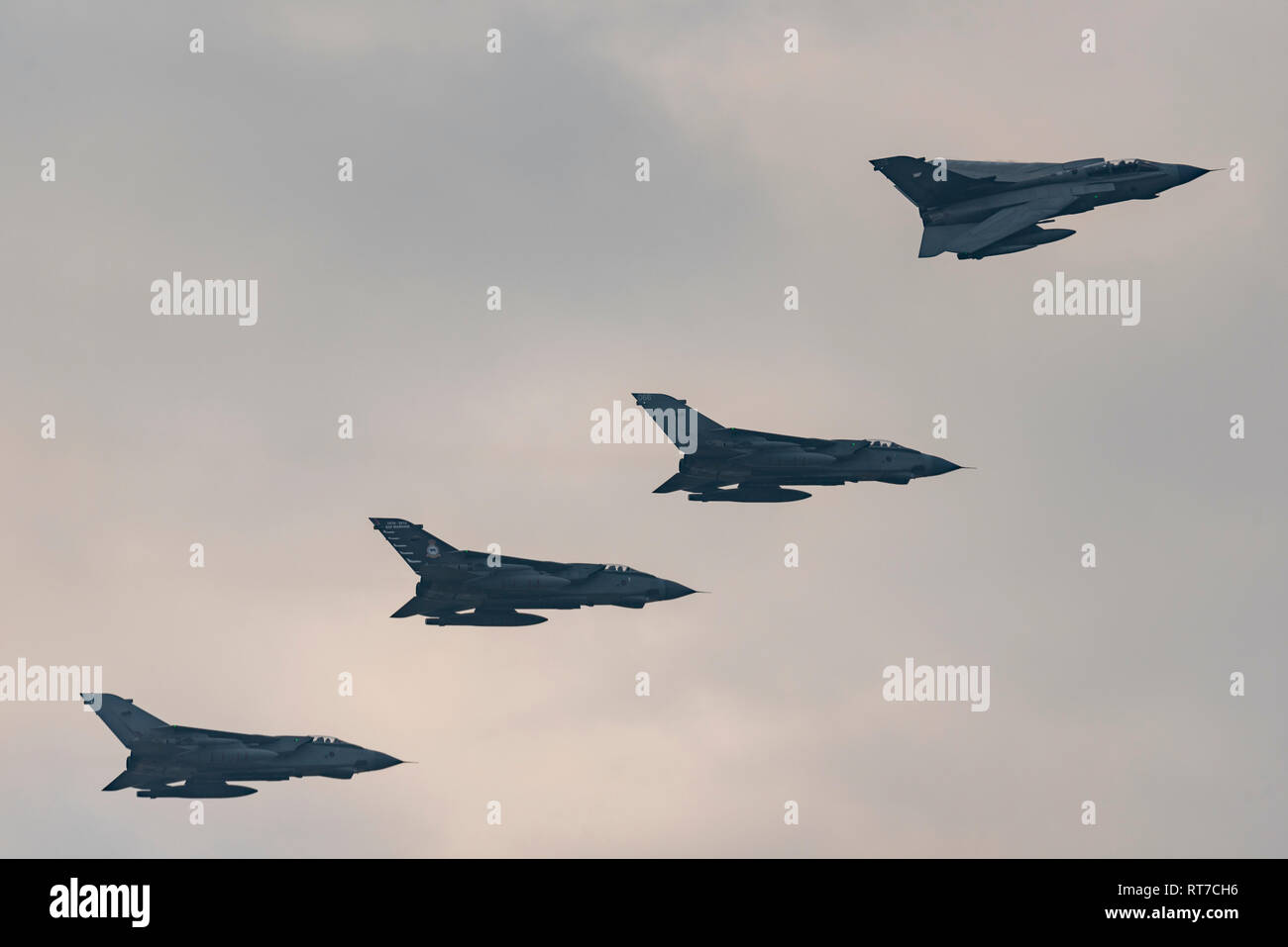 The Royal Air Force is saying farewell to the Panavia Tornado, of which it once operated over 200 of the bomber version. RAF Marham is home to IX and 31 squadrons who share around 16 of the remaining  Tornado GR4 jets before the venerable type ends its service in a few weeks. RAF Tornadoes saw service in the Gulf and Iraq wars as well as peacekeeping missions. Nine Tornadoes flew a formation flypast to mark the drawdown. They will never fly in such numbers again as they continue to be withdrawn Stock Photo