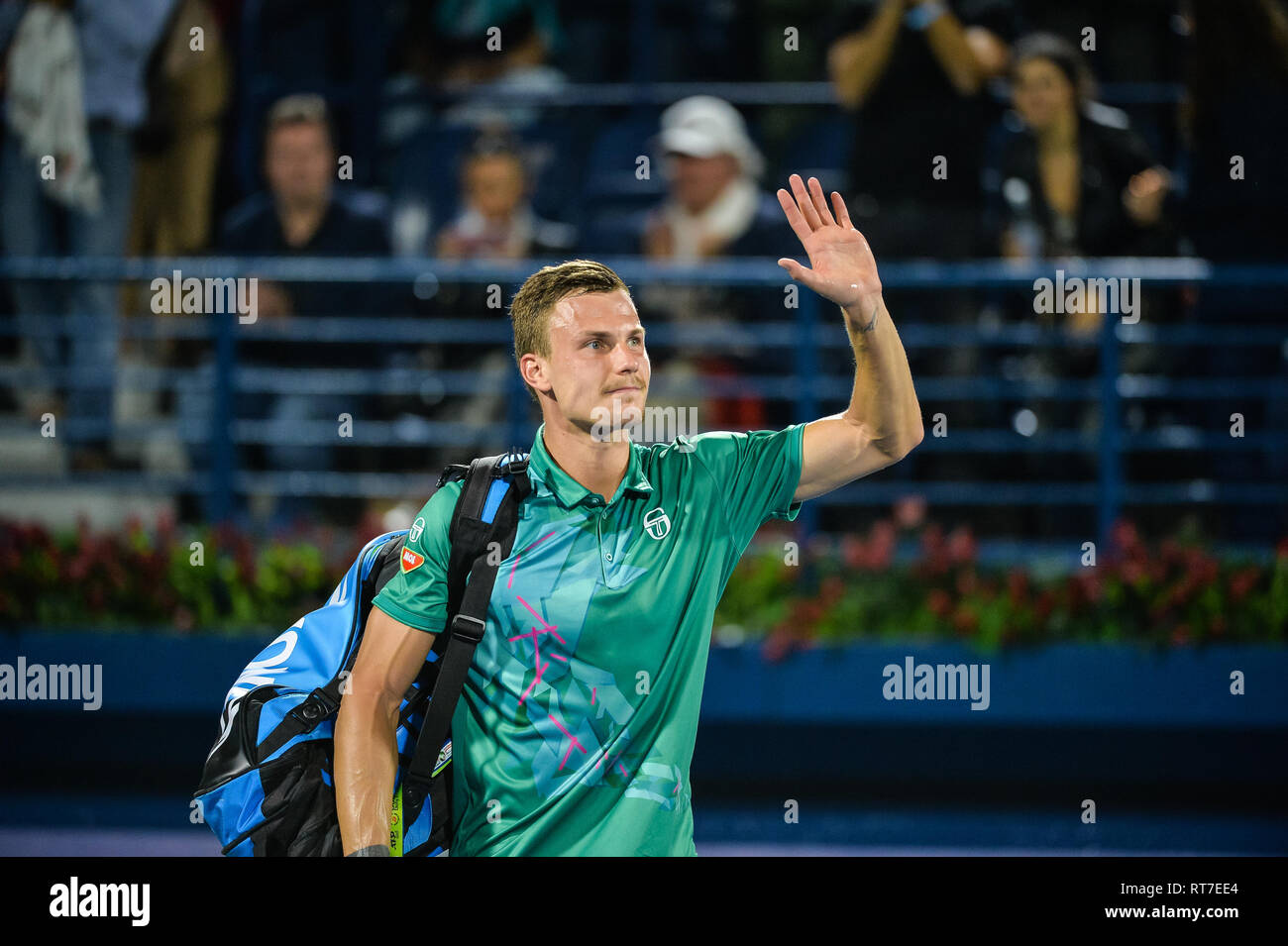 Dubai, UAE. 28th February 2019. Hungarian Marton Fucsovics acknowledges the crowd after losing to former World no. 1 Roger Federer of Switzerland wins in the quarter finals of the 2019 Dubai Duty Free Tennis Championships. Fucsovics lost 6-7 (6-8), 4-6 Credit: Feroz Khan/Alamy Live News - Stock Image