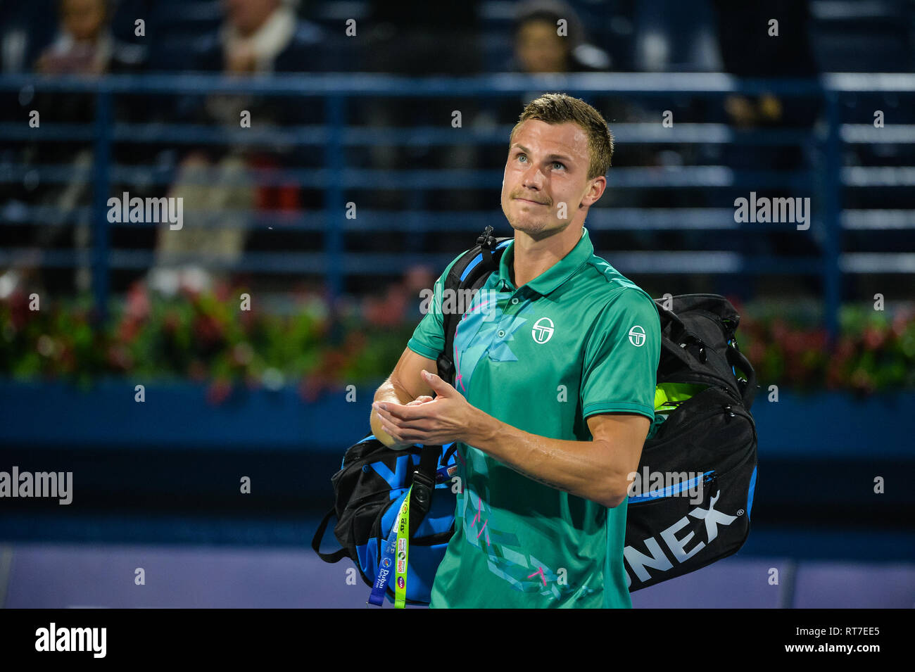 Dubai, UAE. 28th February 2019. Hungarian Marton Fucsovics acknowledges the crowd after losing to former World no. 1 Roger Federer of Switzerland§ in the quarter finals of the 2019 Dubai Duty Free Tennis Championships. Fucsovics lost 6-7 (6-8), 4-6 Credit: Feroz Khan/Alamy Live News - Stock Image