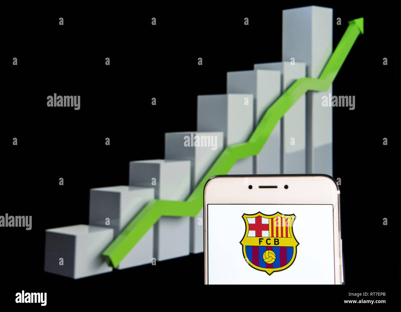 Hong Kong. 11th Feb, 2019. Spanish professional football team the Futbol Club Barcelona logo is seen on an android mobile device with an ascent growth chart in the background. Credit: Miguel Candela/SOPA Images/ZUMA Wire/Alamy Live News - Stock Image