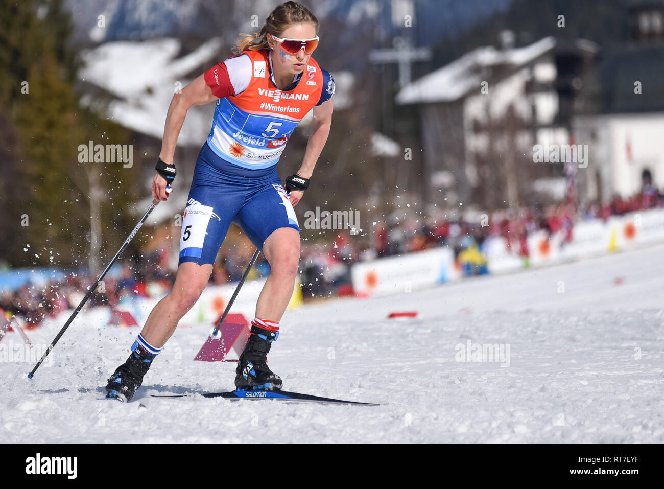 Seefeld, Austria, 28th February, 2019. How hot was it? Jessie Diggins, cut the legs off her racing uniform to race the anchor leg for the US Ski Team's relay team at nordic world ski championships.  Temperatures were in the 50s. The US finished fifth. © John Lazenby/Alamy Live News. - Stock Image