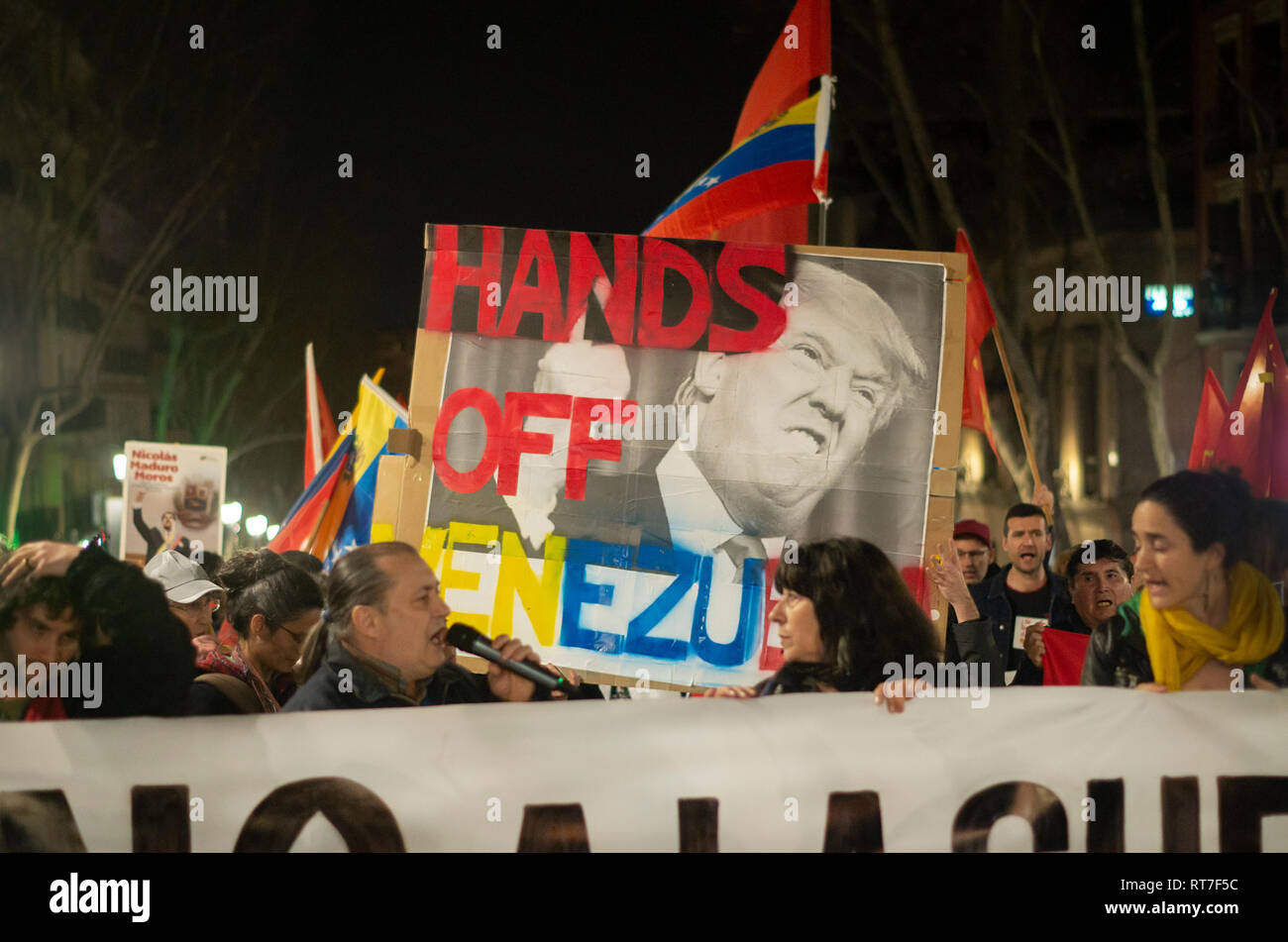 Madrid, Spain. 28th Feb, 2019. Hundreds of people protested against the intervention of United States in Venezuela marching from Atocha to Puerta del Sol in Madrid. Credit: Lora Grigorova/Alamy Live News Stock Photo
