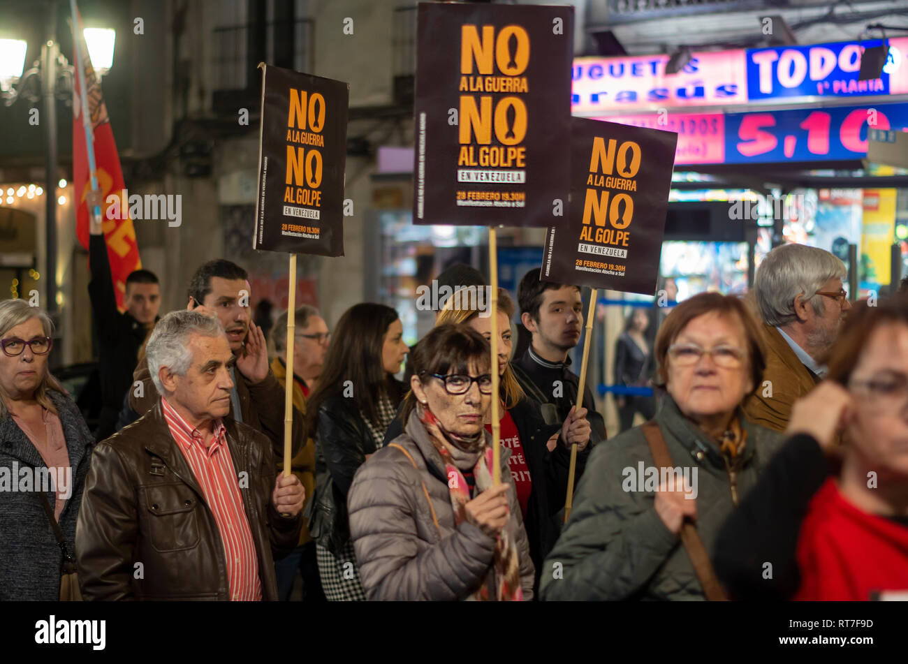 """Madrid, Spain. 28th Feb, 2019. Hundreds of people protested against the intervention of United States in Venezuela marching from Atocha to Puerta del Sol in Madrid. In the picture, people at the protest with placards that says """"No to the coup"""" Credit: Lora Grigorova/Alamy Live News Stock Photo"""