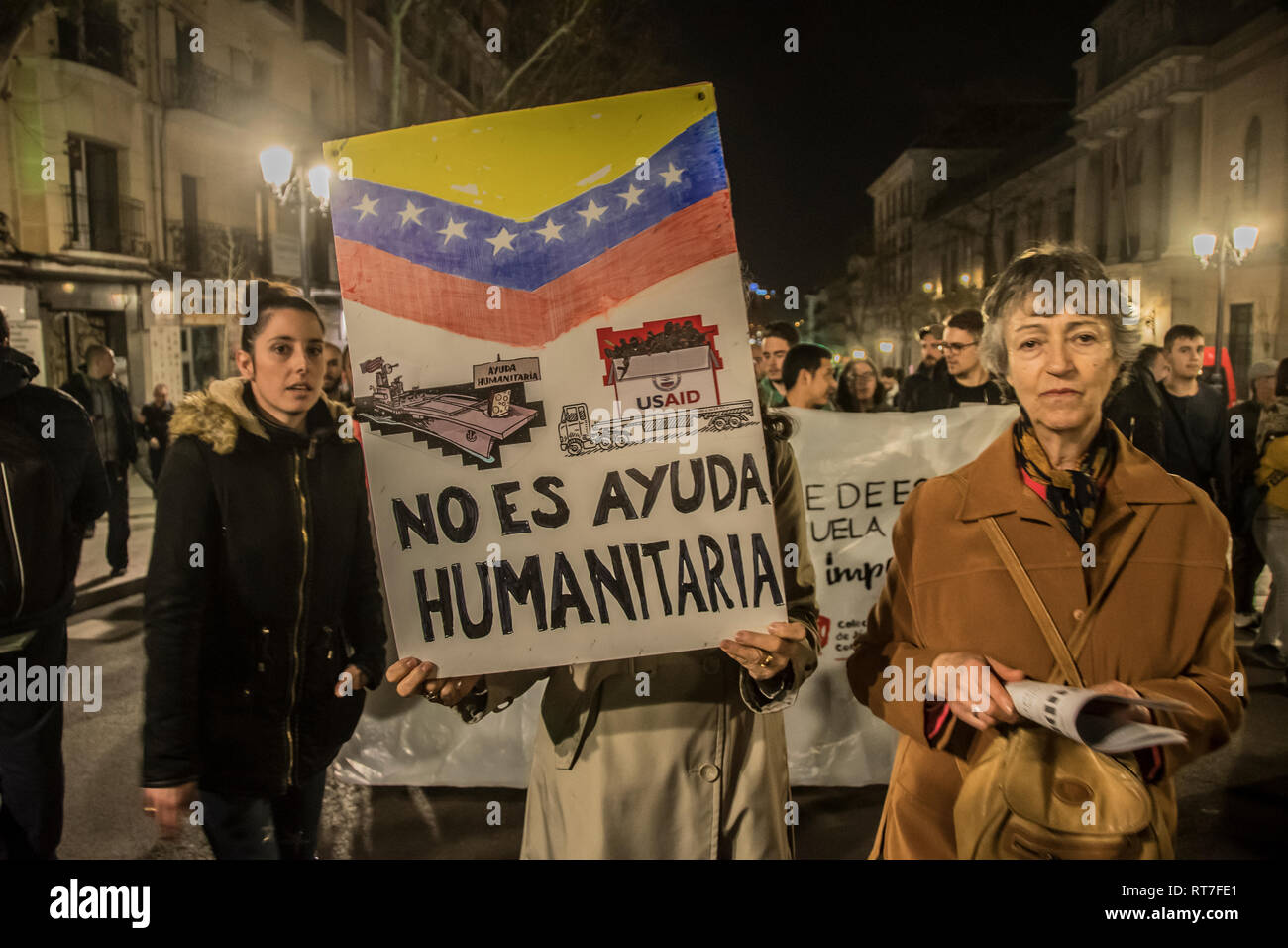 Madrid, Spain. 28th Feb, 2019. March against the military intervention of United States in Venezuela '¨No war intervention'¨in Madrid Spain. In the picture people witha big placard '¨ it is not humanitarian aid'¨ Credit: Alberto Sibaja Ramírez/Alamy Live News - Stock Image