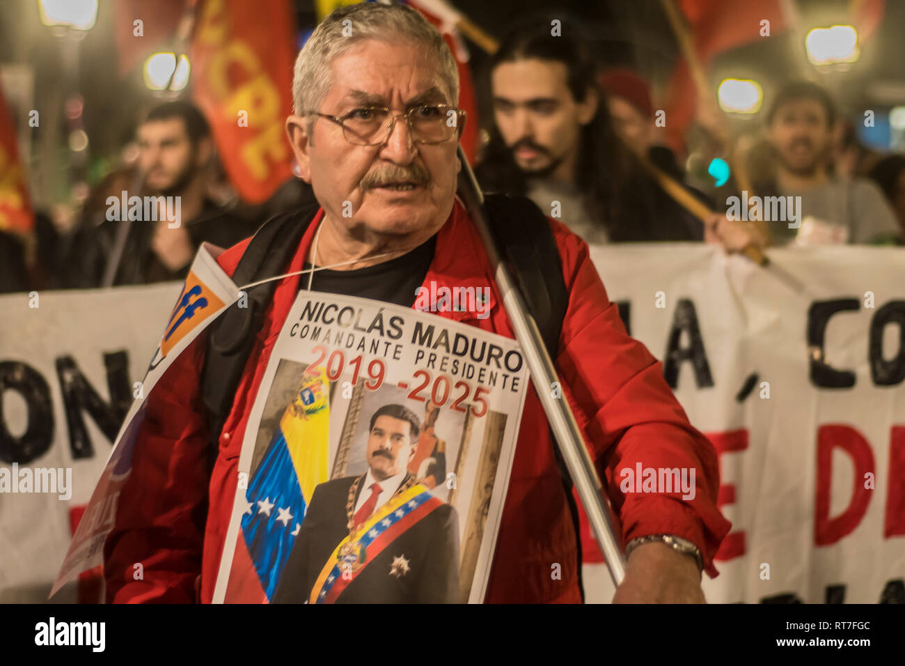 Madrid, Spain. 28th Feb, 2019. March against the military intervention of United States in Venezuela '¨No war intervention'¨in Madrid Spain. In the picture an old man supporting the goverment of Nicolas Maduro'¨ Credit: Alberto Sibaja Ramírez/Alamy Live News - Stock Image