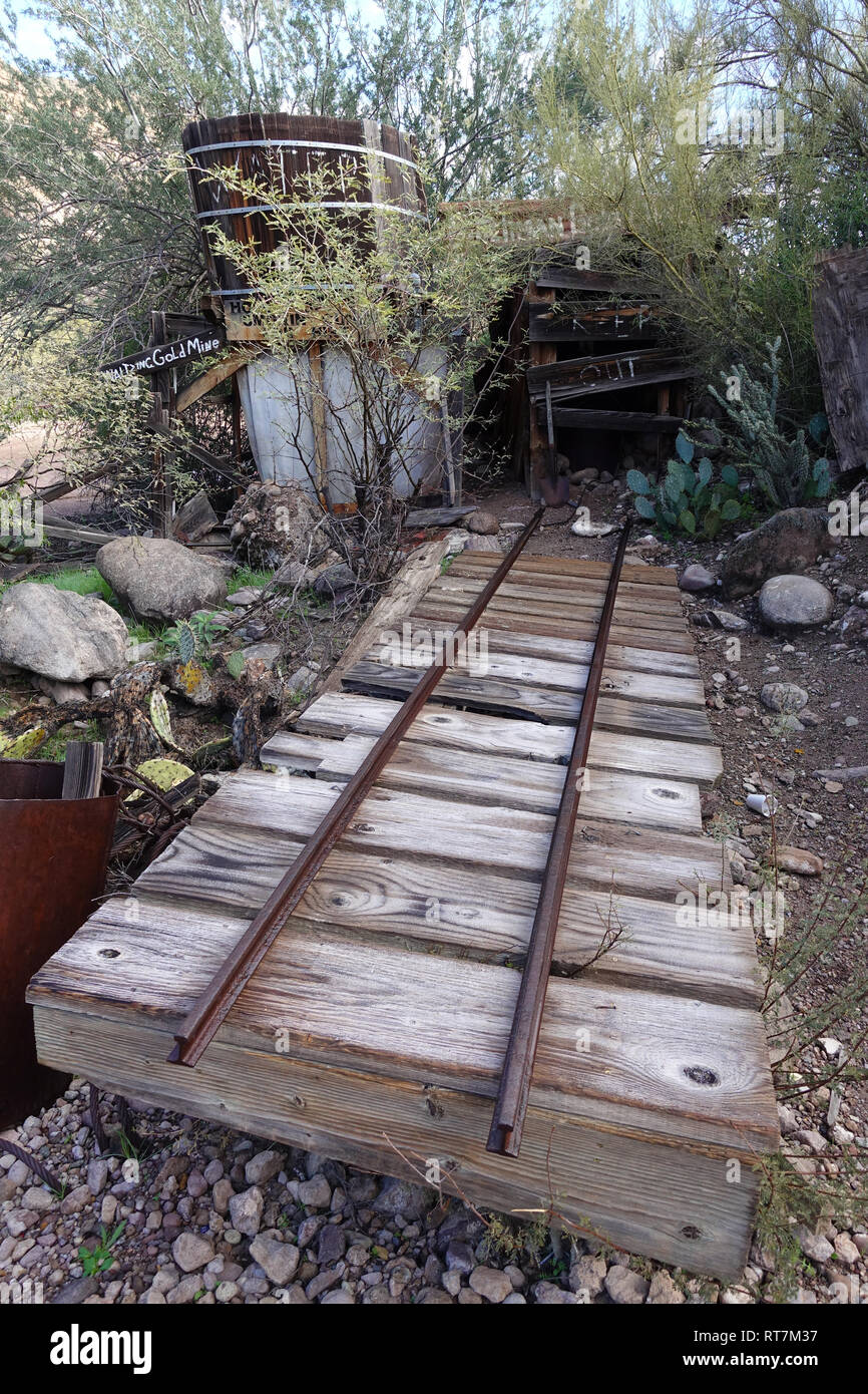 Underneath the mountains and deserts of the U.S. West lie hundreds of thousands of abandoned mines, here rail tracks lead into a mine. - Stock Image