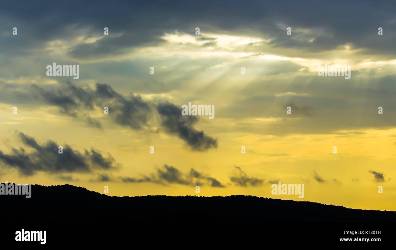Sunrays through the clouds during sunset in Madayipara, Near Payangadi, Kannur, Kerala - Stock Image