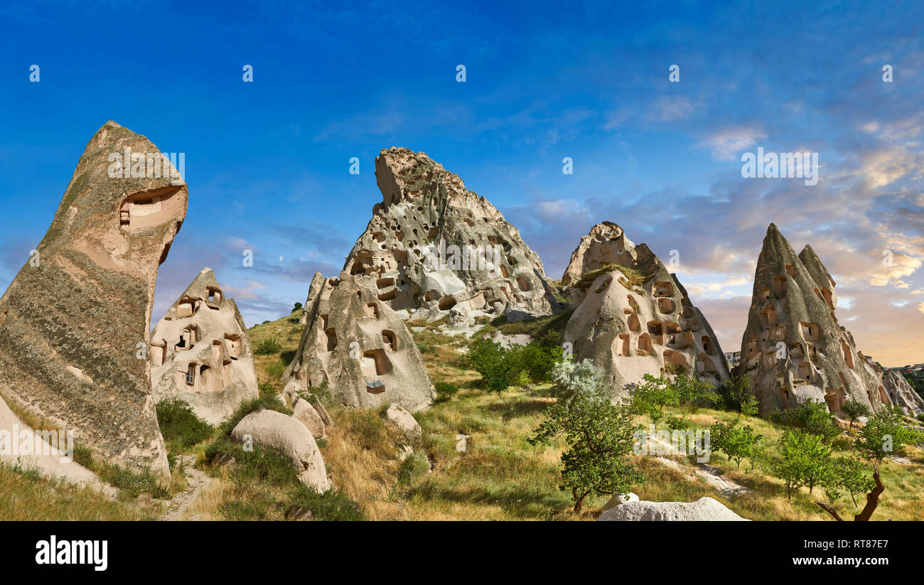 Pictures & images of Uchisar Castle the cave city houses in the fairy chimney of Uchisar, near Goreme, Cappadocia, Nevsehir, Turkey - Stock Image
