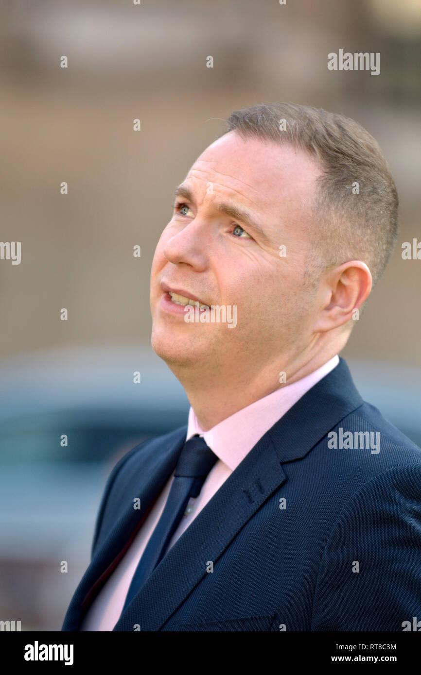 Chris Hazzard MP (Sinn Féin: South Down) interviewed on College Green, Westminster, Feb 2019 - Stock Image