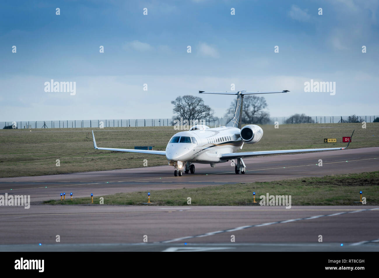 Embraer Legacy 650 G-WIRG business jet aircraft of Air Charter Scotland taxiing at Luton airport, England. Stock Photo