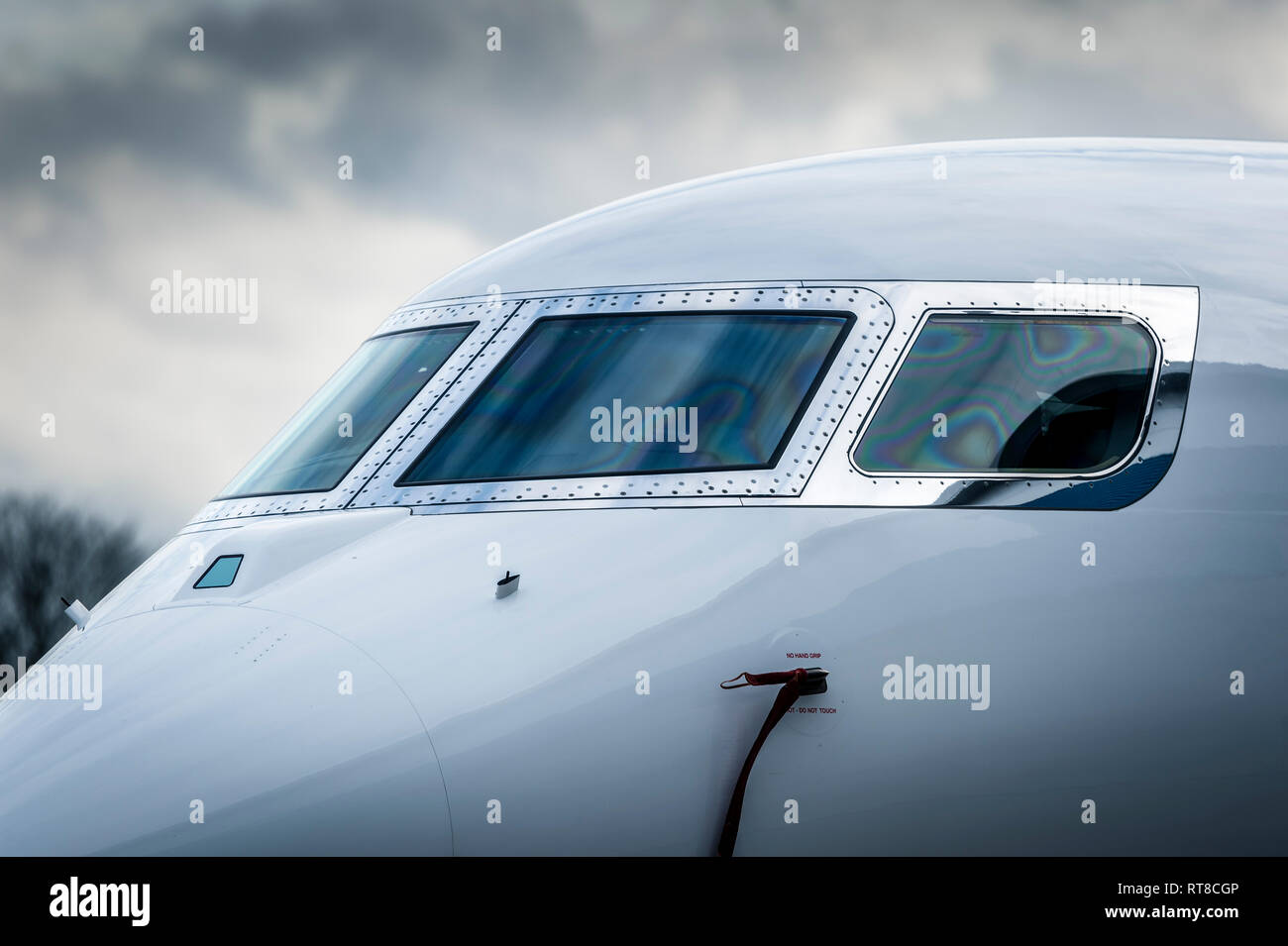 Close up of the front of a business jet aircraft at Luton airport, England. - Stock Image