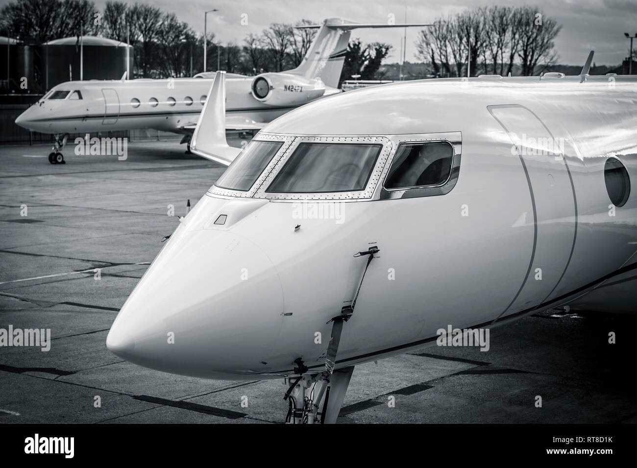 Front of a business jet aircraft at Luton airport, England. - Stock Image