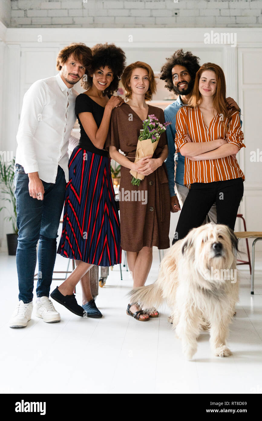 Group picture with a dog, of friends, celebrating ghe birthday og a young woman - Stock Image