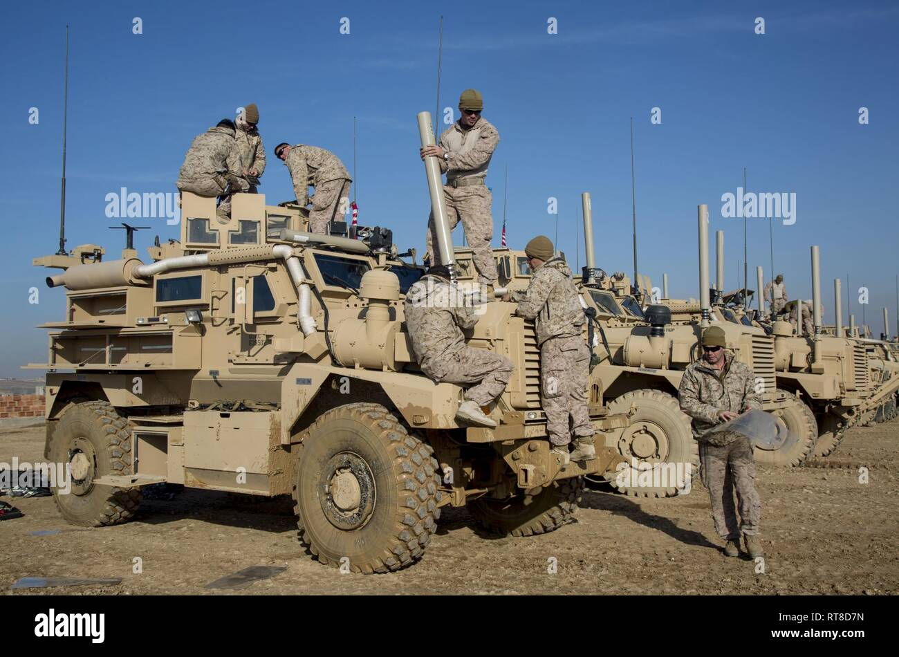 U.S. Marines with India Company, 3rd Battalion, 4th Marine Regiment, attached to Special Purpose Marine Air-Ground Task Force Crisis Response-Central Command, inventory and assemble a mine resistant, ambush-protected vehicle in support of Operation Inherent Resolve, southwest Asia, Jan. 25, 2019.  As a quick reaction force, SPMAGTF-CR-CC Marines utilize the MRAP during mounted convoys to conduct security patrols, working by, with, and through the partner forces to defeat ISIS. Stock Photo