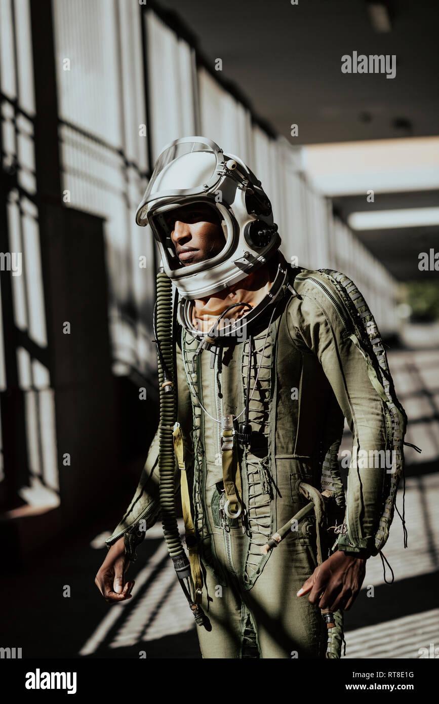 Standing astronaut in spacesuit - Stock Image